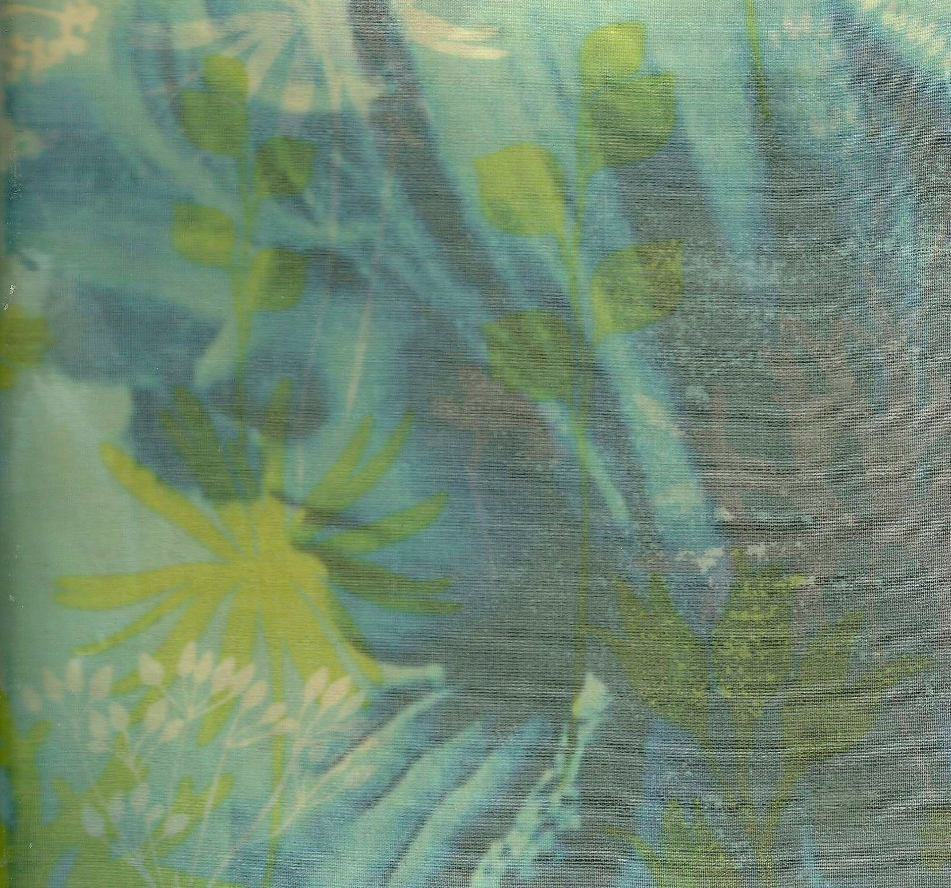 Picture of a woman covered by fabric of blue and green flowers