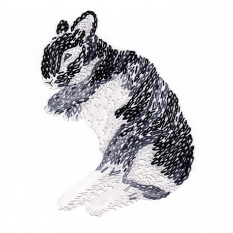 Grey rabbit lying on the side made out of loop stitches